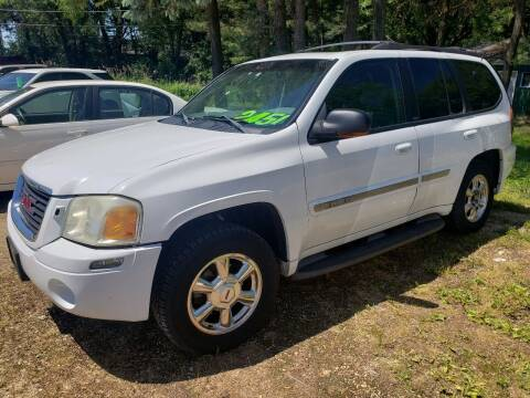 2002 GMC Envoy for sale at Northwoods Auto & Truck Sales in Machesney Park IL