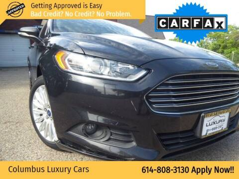 2014 Ford Fusion Hybrid for sale at Columbus Luxury Cars in Columbus OH