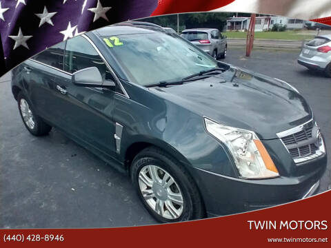 2012 Cadillac SRX for sale at TWIN MOTORS in Madison OH