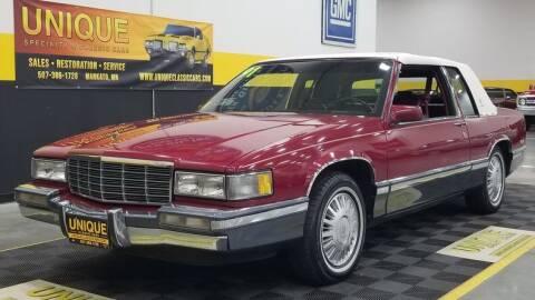 1991 Cadillac DeVille for sale at UNIQUE SPECIALTY & CLASSICS in Mankato MN