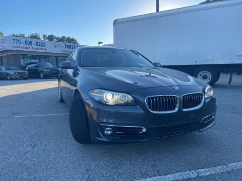 2016 BMW 5 Series for sale at Trust Autos, LLC in Decatur GA
