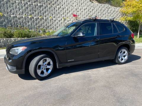 2014 BMW X1 for sale at CALIFORNIA AUTO GROUP in San Diego CA