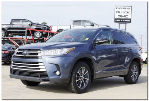 2018 Toyota Highlander for sale at STRICKLAND AUTO GROUP INC in Ahoskie NC