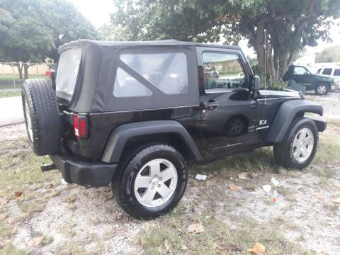 2009 Jeep Wrangler for sale at LAND & SEA BROKERS INC in Deerfield FL