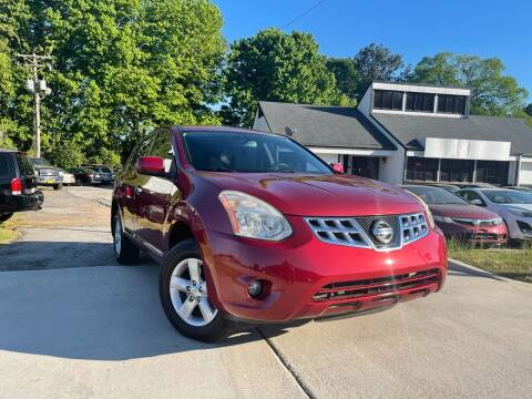 2013 Nissan Rogue for sale at Alpha Car Land LLC in Snellville GA