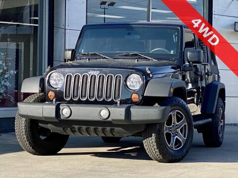2013 Jeep Wrangler Unlimited for sale at Carmel Motors in Indianapolis IN