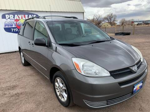 2004 Toyota Sienna for sale at Praylea's Auto Sales in Peyton CO