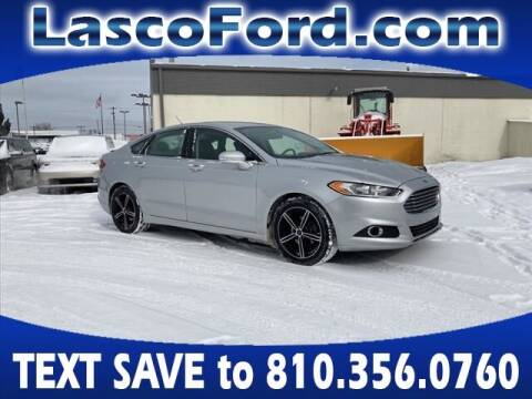 2014 Ford Fusion for sale at Lasco of Grand Blanc in Grand Blanc MI
