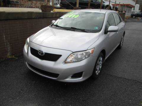 2010 Toyota Corolla for sale at WORKMAN AUTO INC in Pleasant Gap PA