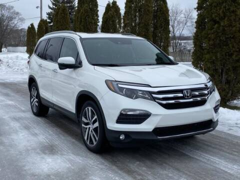 2018 Honda Pilot for sale at Betten Baker Preowned Center in Twin Lake MI