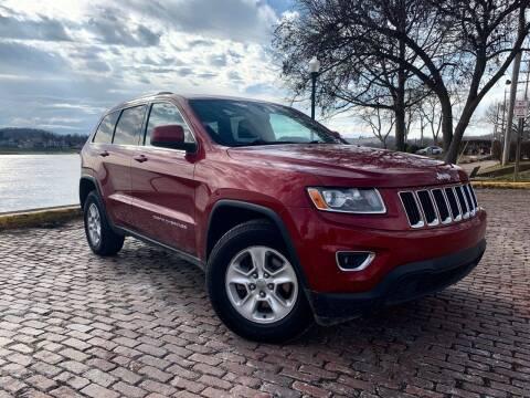 2014 Jeep Grand Cherokee for sale at PUTNAM AUTO SALES INC in Marietta OH