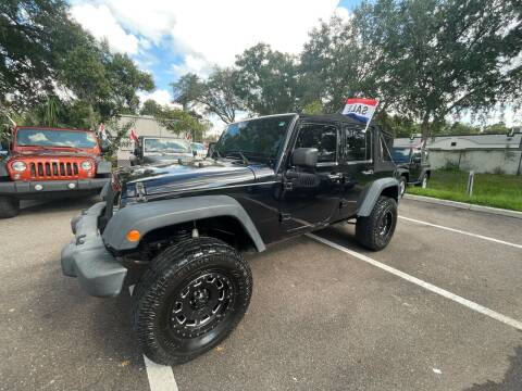 2012 Jeep Wrangler Unlimited for sale at Bay City Autosales in Tampa FL