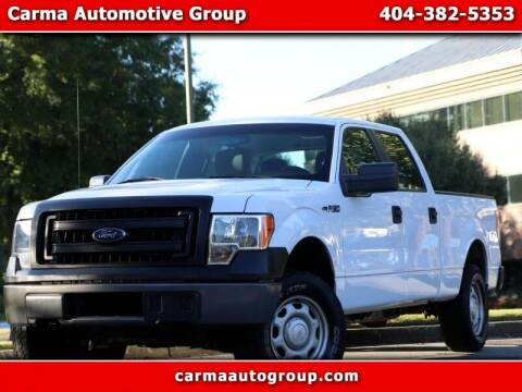 2013 Ford F-150 for sale at Carma Auto Group in Duluth GA
