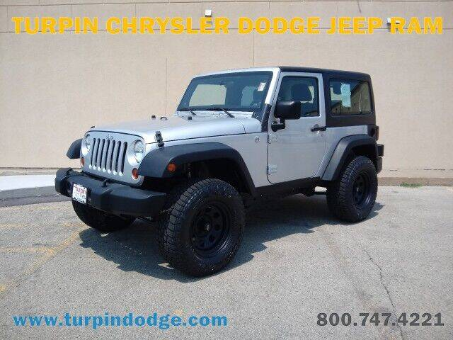2011 Jeep Wrangler for sale at Turpin Dodge Chrysler Jeep Ram in Dubuque IA