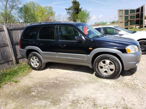 2002 Mazda Tribute for sale at Northwoods Auto & Truck Sales in Machesney Park IL