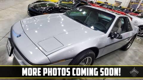 1988 Pontiac Fiero for sale at UNIQUE SPECIALTY & CLASSICS in Mankato MN