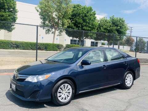 2014 Toyota Camry for sale at CARLIFORNIA AUTO WHOLESALE in San Bernardino CA