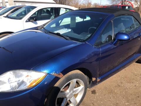 2009 Mitsubishi Eclipse Spyder for sale at BARNES AUTO SALES in Mandan ND