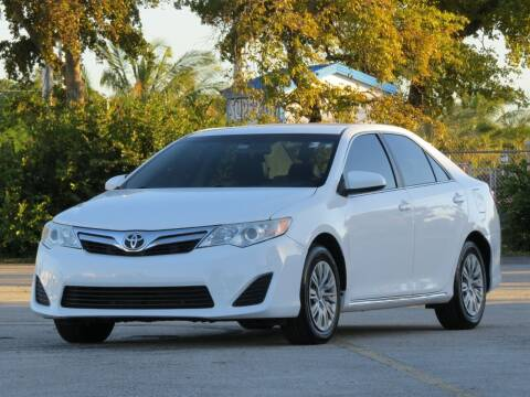2014 Toyota Camry for sale at DK Auto Sales in Hollywood FL