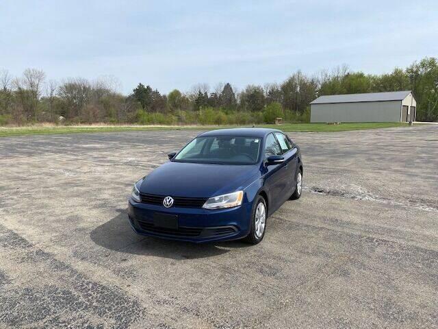 2014 Volkswagen Jetta for sale at Caruzin Motors in Flint MI