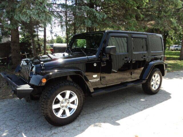 2011 Jeep Wrangler Unlimited for sale at HUSHER CAR COMPANY in Caledonia WI