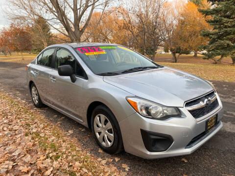 2012 Subaru Impreza for sale at BELOW BOOK AUTO SALES in Idaho Falls ID