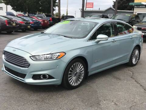 2013 Ford Fusion Hybrid for sale at Capitol Auto Sales in Lansing MI