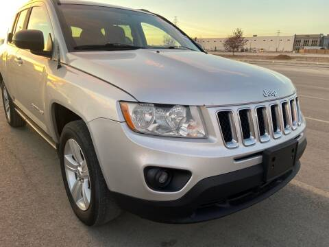 2013 Jeep Compass for sale at BELOW BOOK AUTO SALES in Idaho Falls ID