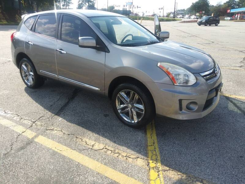 2011 Nissan Rogue for sale at Magwood Auto Dealers LLC in Jonesboro GA