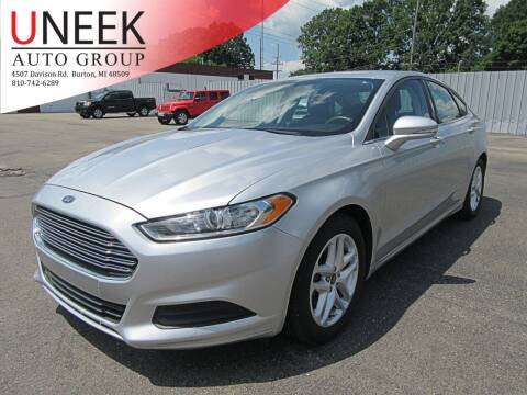 2016 Ford Fusion for sale at Uneek Auto Group LLC in Burton MI