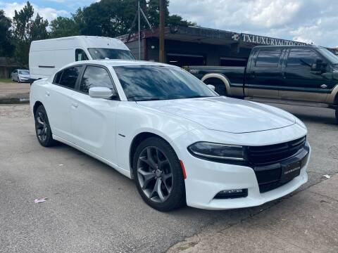 2015 Dodge Charger for sale at Texas Luxury Auto in Houston TX