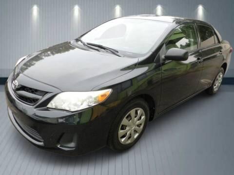 2011 Toyota Corolla for sale at Klean Carz in Seattle WA