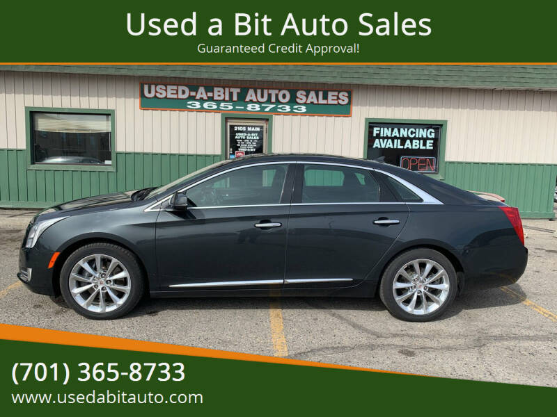 2013 Cadillac XTS for sale at Used a Bit Auto Sales in Fargo ND