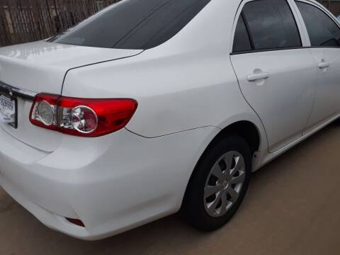 2013 Toyota Corolla for sale at Auto Haus Imports in Grand Prairie TX