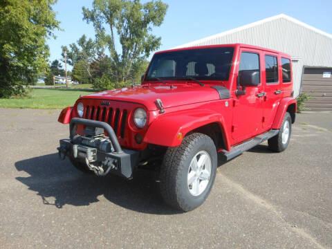 2011 Jeep Wrangler Unlimited for sale at DANCA'S KAR KORRAL INC in Turtle Lake WI