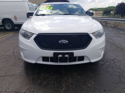2014 Ford Taurus for sale at Discovery Auto Sales in New Lenox IL