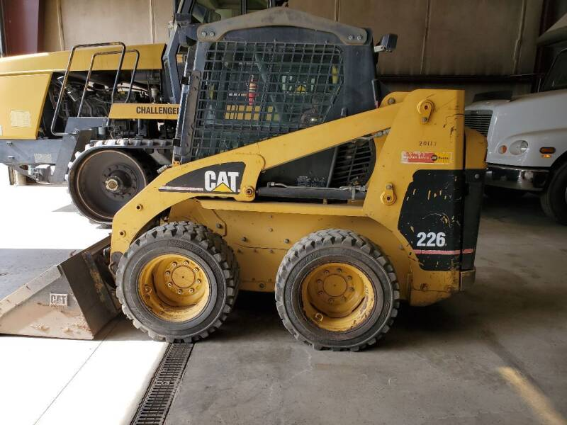 1998 Caterpillar 215 for sale at HIGH COUNTRY MOTORS in Granby CO
