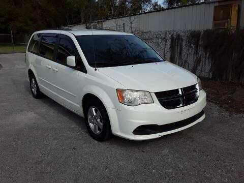 2013 Dodge Grand Caravan for sale at Louie's Auto Sales in Leesburg FL