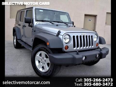 2013 Jeep Wrangler Unlimited for sale at Selective Motor Cars in Miami FL