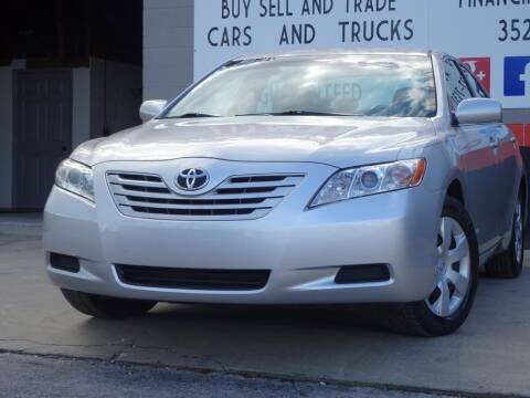 2009 Toyota Camry for sale at Deal Maker of Gainesville in Gainesville FL