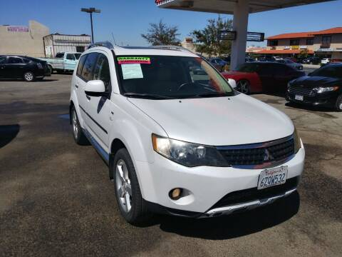 2009 Mitsubishi Outlander for sale at Best Buy Auto Sales in Hesperia CA