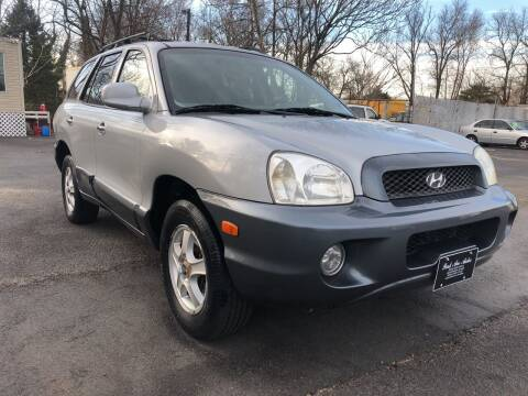 2004 Hyundai Santa Fe for sale at PARK AVENUE AUTOS in Collingswood NJ