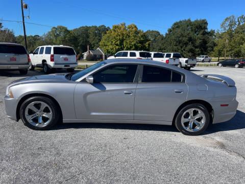 2014 Dodge Charger for sale at TAVERN MOTORS in Laurens SC