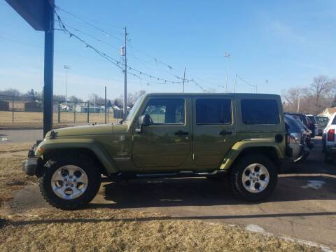 2013 Jeep Wrangler Unlimited for sale at RIVERSIDE AUTO SALES in Sioux City IA