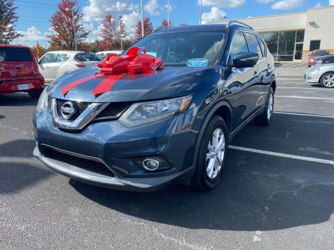 2015 Nissan Rogue for sale at Charlotte Auto Group, Inc in Monroe NC
