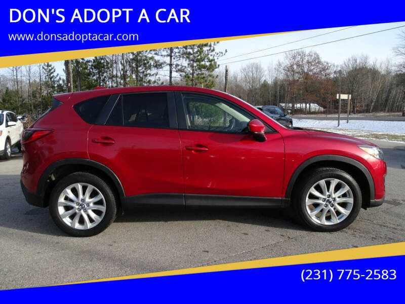 2014 Mazda CX-5 for sale at DON'S ADOPT A CAR in Cadillac MI