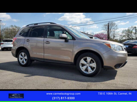 2014 Subaru Forester for sale at Carmel Auto Group in Indianapolis IN
