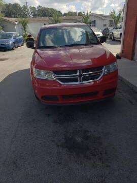 2013 Dodge Journey for sale at Credit Cars LLC in Lawrenceville GA
