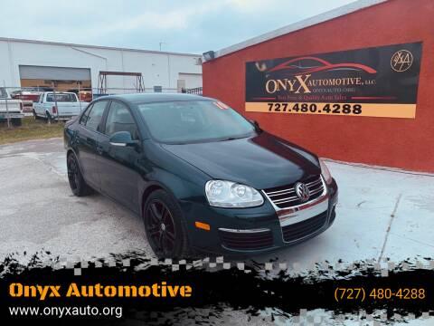 2010 Volkswagen Jetta for sale at ONYX AUTOMOTIVE, LLC in Largo FL