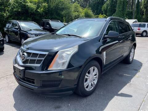 2011 Cadillac SRX for sale at Magic Motors Inc. in Snellville GA
